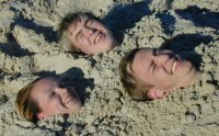 Monica, Simen and Thomas buried in the sand
